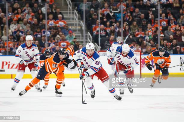 Jesse Puljujarvi of the Edmonton Oilers chases after John Gilmour of the New York Rangers at Rogers Place on March 3 2018 in Edmonton Canada