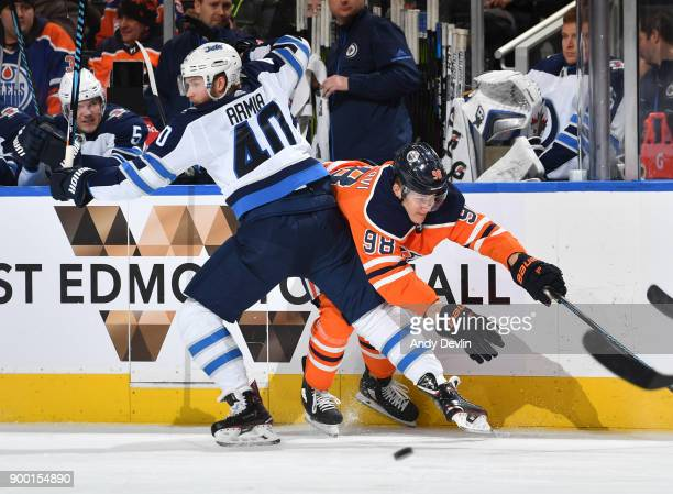 Jesse Puljujarvi of the Edmonton Oilers collides with Joel Armia of the Winnipeg Jets on December 31 2017 at Rogers Place in Edmonton Alberta Canada