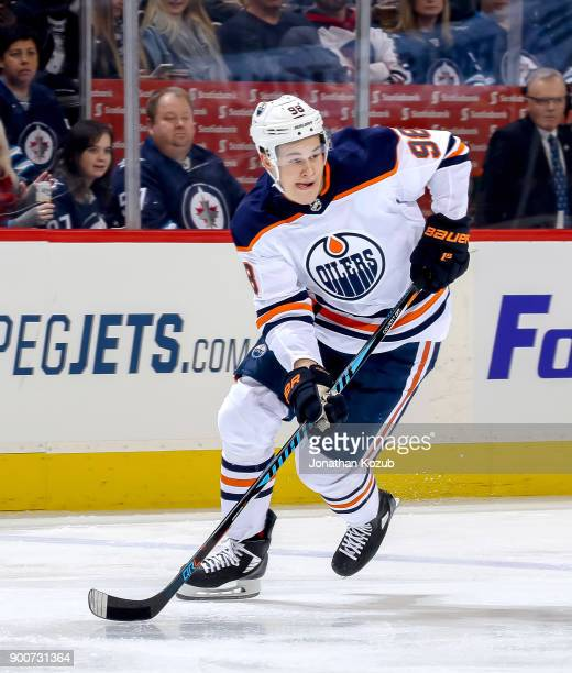 Jesse Puljujarvi of the Edmonton Oilers follows the play down the ice during first period action against the Winnipeg Jets at the Bell MTS Place on...