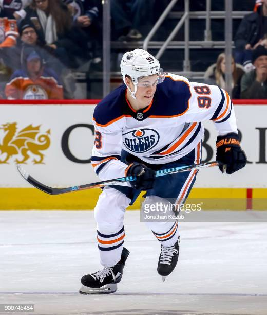 Jesse Puljujarvi of the Edmonton Oilers follows the play up the ice during first period action against the Winnipeg Jets at the Bell MTS Place on...
