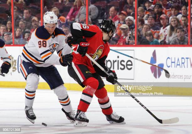 Jesse Puljujarvi of the Edmonton Oilers gets the puck past Christian Wolanin of the Ottawa Senators in the first period at Canadian Tire Centre on...