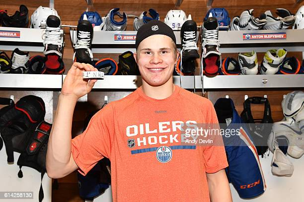 Jesse Puljujarvi of the Edmonton Oilers poses with the puck after scoring his first NHL goal during the season opener against the Calgary Flames on...