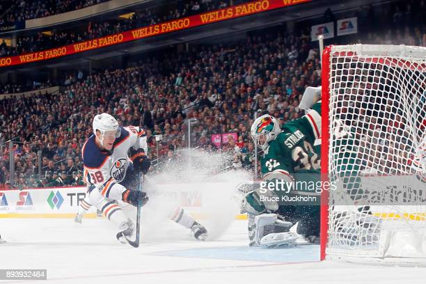 Jesse Puljujarvi of the Edmonton Oilers scores a goal against Alex Stalock of the Minnesota Wild during the game at the Xcel Energy Center on...