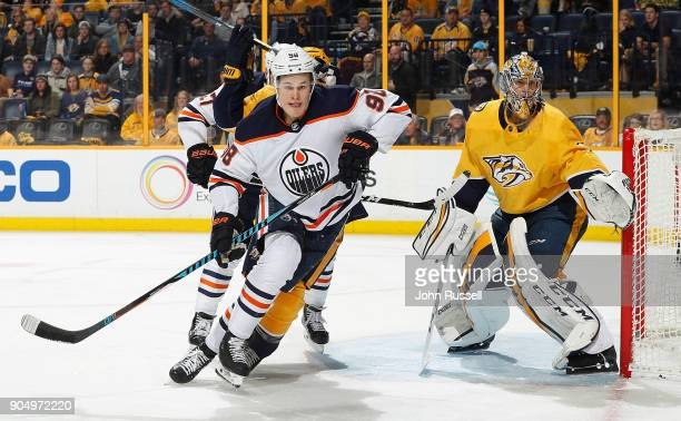 Jesse Puljujarvi of the Edmonton Oilers skates against Pekka Rinne of the Nashville Predators during an NHL game at Bridgestone Arena on January 9...