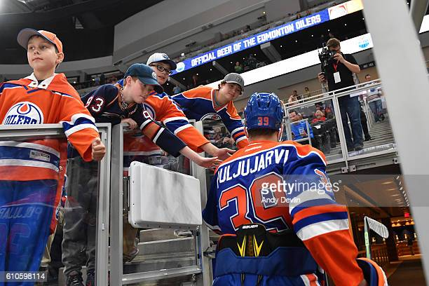 Jesse Puljujarvi of the Edmonton Oilers walks to the dressing room prior to a preseason game against the Calgary Flames on September 26 2016 at...
