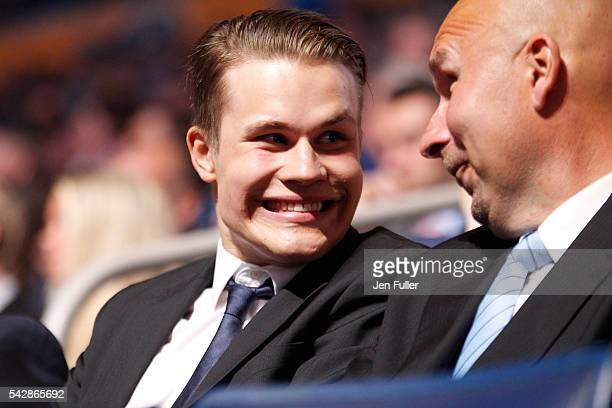 Jesse Puljujarvi reacts to the NHL draft screen before being picked fourth overall by the Edmonton Oilers during round one of the 2016 NHL Draft on...