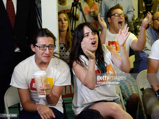 Jesse Quintalla and Jessica Parral react to the Supreme Court ruling at a watch party at Equality California a nonprofit civil rights organization...