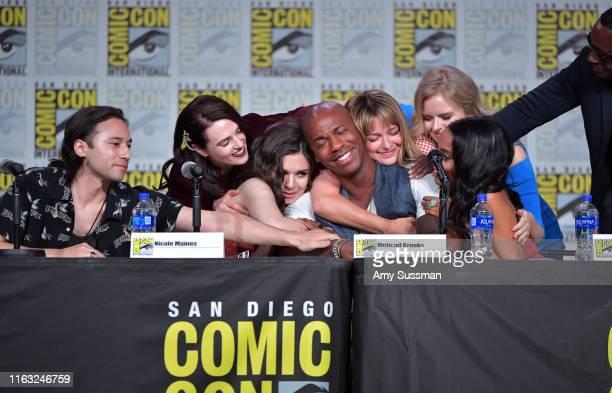 Jesse Rath Katie McGrath Nicole Maines Mechad Brooks Melissa Benoist Andrea Brooks Azie Tesfai and David Harewood embrace at the Supergirl Special...