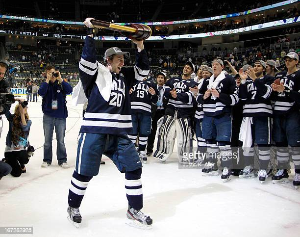 Jesse Root of the Yale Bulldogs celebrates after defeating the Quinnipiac Bobcats in the Men's Ice Hockey National Championship Game at Consol Energy...