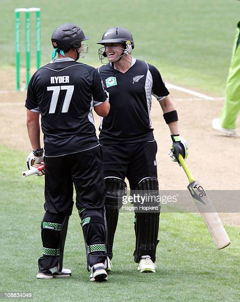 Jesse Ryder of the Black Caps is congratulated for scoring a century by teammate Scott Styris during game six of the one day series between New...