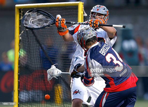 Jesse Schwartzman of the Denver Outlaws does not stop a shot by Colin Briggs of the Boston Cannons in the first half at Harvard Stadium on May 11,...