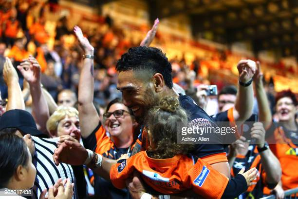 Jesse SeneLefao of Castleford Tigers celebrates with his family and castleford fans during the Roger Millward Trophy match between Hull KR and...