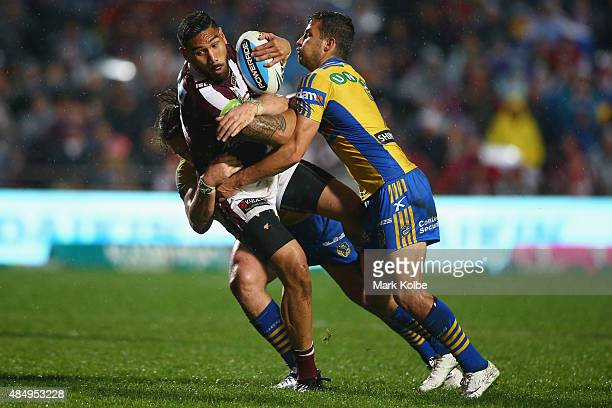 Jesse SeneLefao of the Eagles is tackled during the round 24 NRL match between the Manly Warringah Sea Eagles and the Parramatta Eels at Brookvale...
