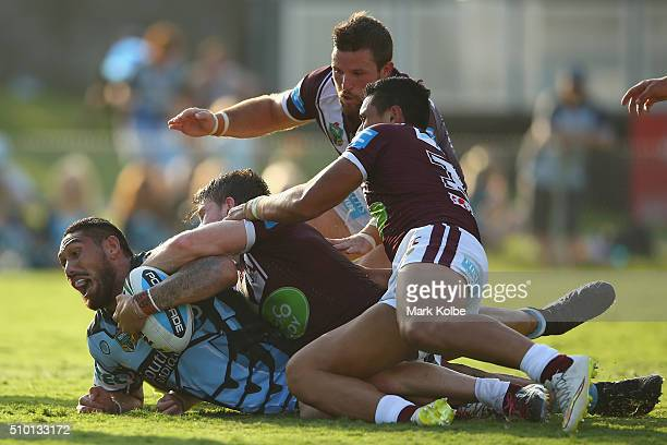 Jesse Sene-Lefao of the Sharks is tackled short of the try line during the NRL Trial match between the Cronulla Sharks and the Manly Sea Eagles at...