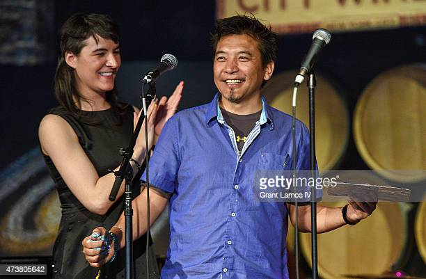 Jesse Smith and artist Tara Lobsang at the Everest Awakening A Prayer For Nepal And Beyond at City Winery on May 17 2015 in New York City