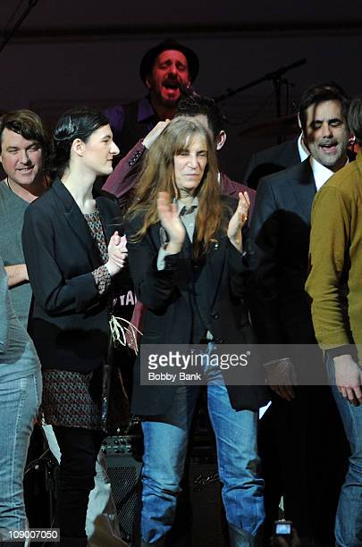 Jesse Smith and her mother Patti Smith and the full ensemble during the encore performing Ohio for The Music of Neil Young at Carnegie Hall on...