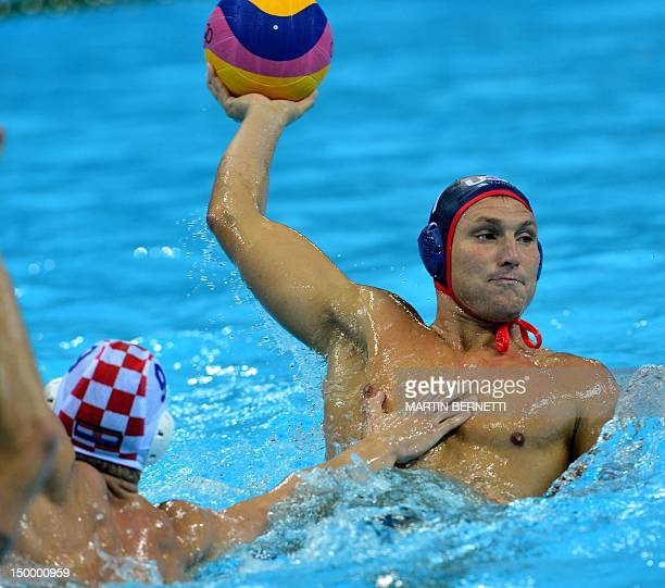 US Jesse Smith is challenged by Croatia's Sandro Sukno during their men's water polo quarterfinal round match of the London 2012 Olympic Games at the...