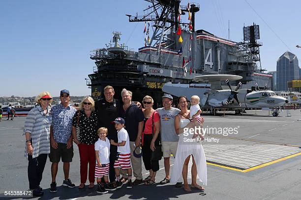 Jesse Smith of Team USA poses for a group photo with his family during the USA Men's Olympic Water Polo Team announcement onboard the USS Midway on...