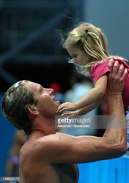 Jesse Smith of the United States celebrates winning the Men's Water Polo Preliminary Round Group B match against Montenegro with his daughter on Day...