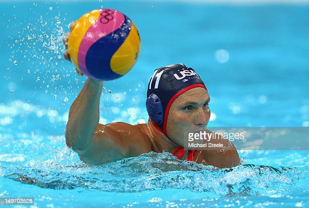 Jesse Smith of the United States competes during the Men's Water Polo Preliminary Round match between Great Britain and the United States at the...