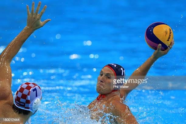 Jesse Smith of the United States looks to pass the ball in the Men's Water Polo Quarterfinal match between Croatia and the United States on Day 12 of...