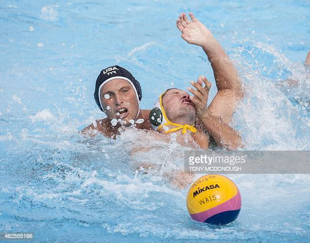 Jesse Smith of the US tackles Jarrod Gilchrist for Australia in their water polo match during day two of the Aquatic Super Series swimming...