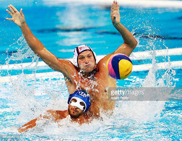 Jesse Smith of the USA marks Matteo Aicardi of Italy during the USA vs Italy Waterpolo group match at Julio de Lamare Aquatics Centre on August 14...