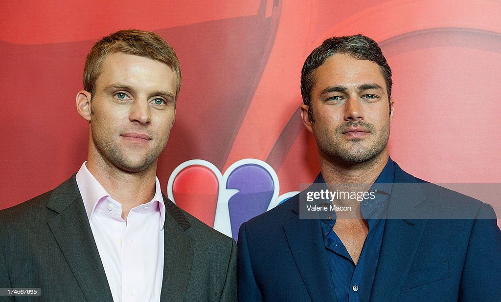 Jesse Spencer and Taylor Kinney arrives at the NBCUniversal's '2013 Summer TCA Tour' at The Beverly Hilton Hotel on July 27, 2013 in Beverly Hills, California.