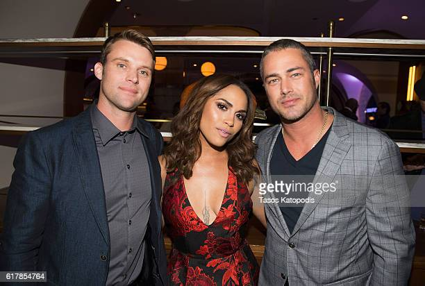 Jesse Spencer Monica Raymund and Taylor Kinney attends the NBC's Chicago series fall season kickoff party on October 24 2016 in Chicago Illinois