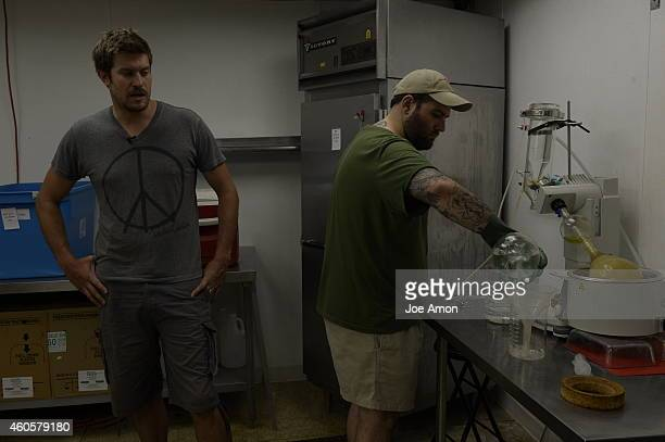 Jesse Stanley with extractor Frank Bianco during a Charlotte's Web ethanol extraction the solution is heated in a rotary evaporator from a highCBD...