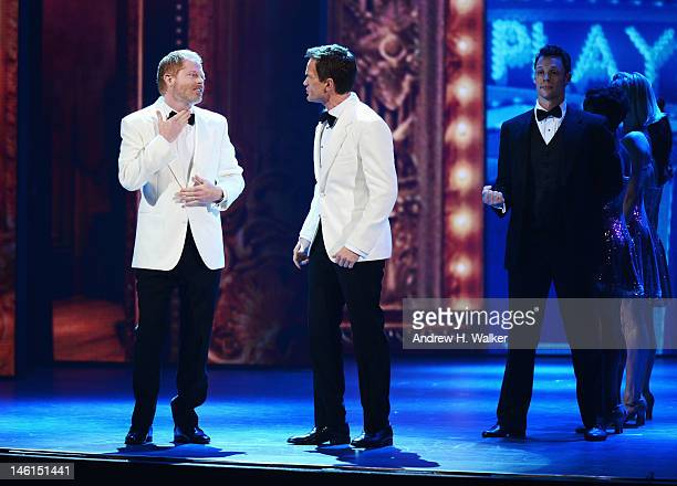Jesse Tyler Ferguson and host Neil Patrick Harris perform onstage at the 66th Annual Tony Awards at The Beacon Theatre on June 10 2012 in New York...