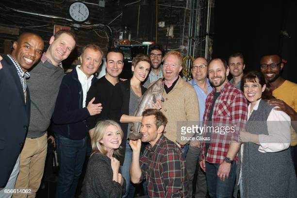 Jesse Tyler Ferguson and husband Justin Mikita pose backstage with the cast of the hit musical Come From Away on Broadway at The Schoenfeld Theatre...
