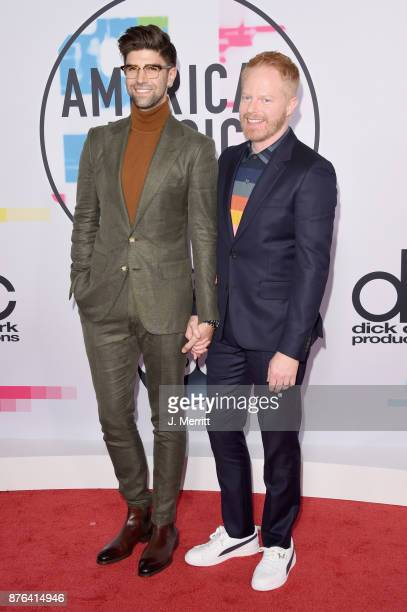 Jesse Tyler Ferguson and Justin Mikita attend 2017 American Music Awards at Microsoft Theater on November 19 2017 in Los Angeles California