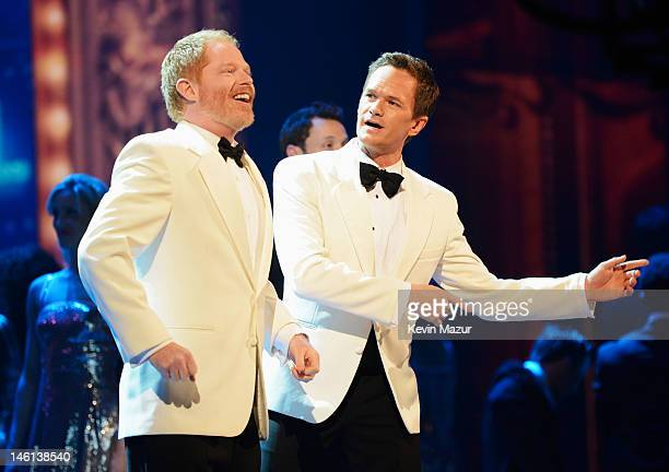 Jesse Tyler Ferguson and Neil Patrick Harris perform onstage at the 66th Annual Tony Awards at The Beacon Theatre on June 10 2012 in New York City