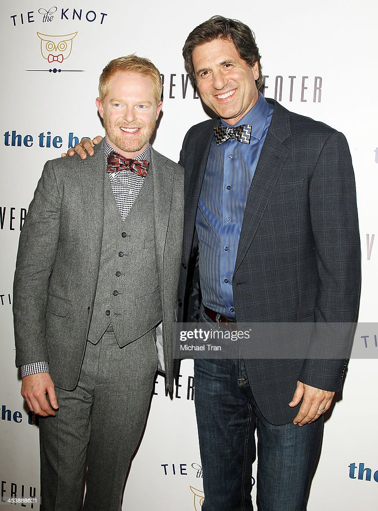 Jesse Tyler Ferguson (L) and Steven Levitan arrive at the 'Tie The Knot' pop-up store opening held at The Beverly Center on December 5, 2013 in Los Angeles, California.