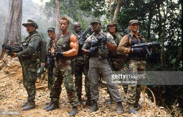 Jesse Ventura Arnold Schwarzenegger and Carl Weathers on the set of 'Predator'
