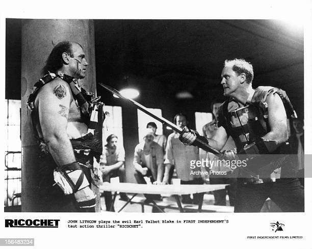 Jesse Ventura is intimidated by a knife yielding John Lithgow in a scene from the film 'Ricochet' 1991