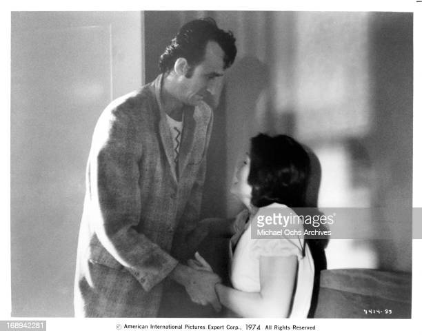 Jesse Vint holds Joan Blackman in a scene from the film 'Macon County Line' 1974