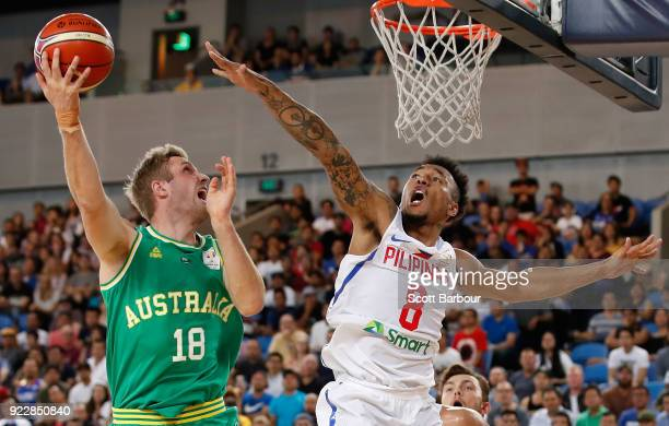 Jesse Wagstaff of the Boomers and Calvin Abueva of the Philippines compete for the ball during the FIBA World Cup Qualifier match between the...