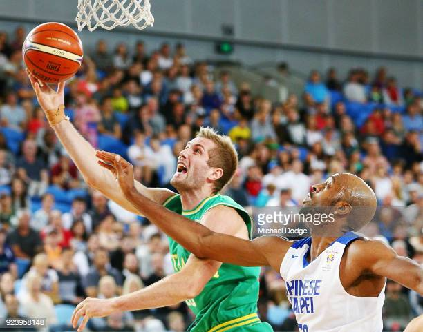Jesse Wagstaff of the Boomers shoots past Quincy Spencer Davis III of Chinese Taipei during the FIBA World Cup Qualifying match between the...