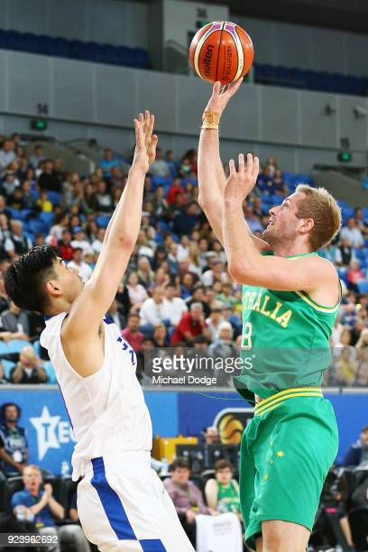 Jesse Wagstaff of the Boomers shoots past Ying Chun Chen of Chinese Taipei during the FIBA World Cup Qualifying match between the Australian Boomers...