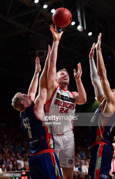 Jesse Wagstaff of the Perth Wildcats shoots over Brendan Teys of the Adelaide 36ers during the round 14 NBL match between the Adelaide 36ers and the...