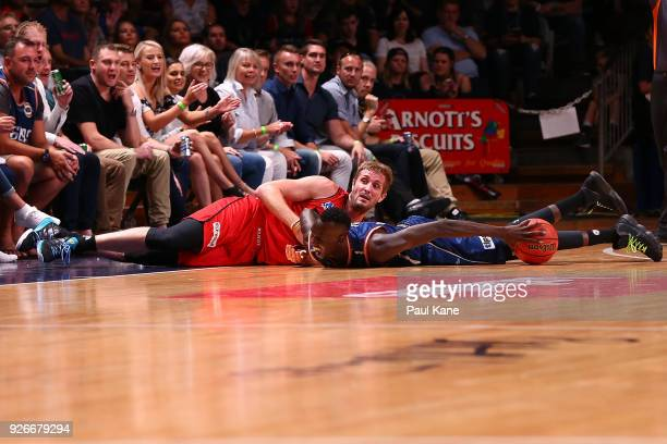 Jesse Wagstaff of the Wildcats and Majok Deng of the 36ers look on after contesting a loose ball during game one of the Semi Final series between the...