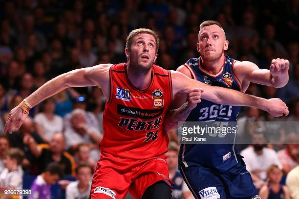 Jesse Wagstaff of the Wildcats and Mitchell Creek of the 36ers contest for position at freethrow during game one of the Semi Final series between the...