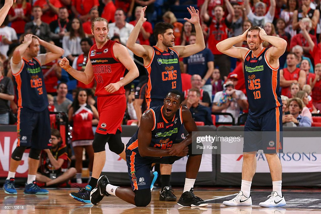 Jesse Wagstaff of the Wildcats celebrates a call as Mark Worthington, Stephen Weigh, Nnanna Egwu and Mitch McCarron of the Taipans react after Bryce Cotton of the Wildcats was fouled in the dying seconds of the game during the round 16 NBL match between the Perth Wildcats and the Cairns Taipans at Perth Arena on January 20, 2017 in Perth, Australia.