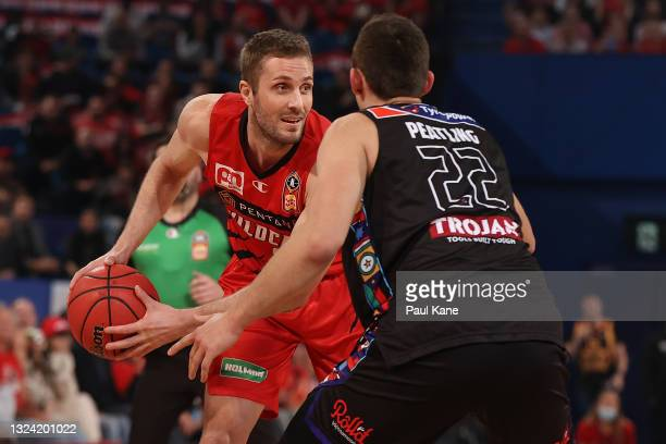 Jesse Wagstaff of the Wildcats controls the ball against Mason Peatling of Melbourne United during game one of the NBL Grand Final Series between the...