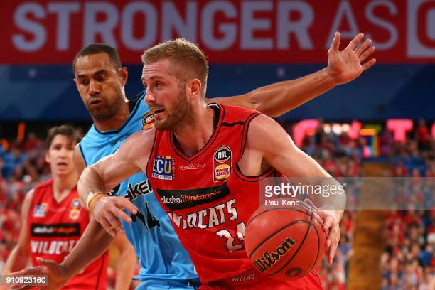 Jesse Wagstaff of the Wildcats drives to the basket against Mika Vukona of the Breakers during the round 16 NBL match between the Perth Wildcats and...