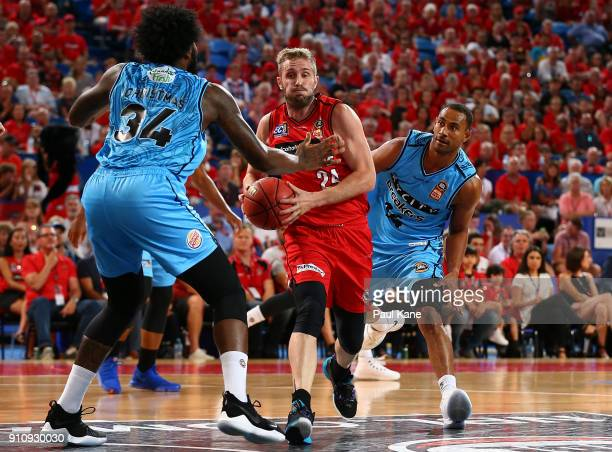 Jesse Wagstaff of the Wildcats drives to the basket against Rakeem Christmas of the Breakers during the round 16 NBL match between the Perth Wildcats...