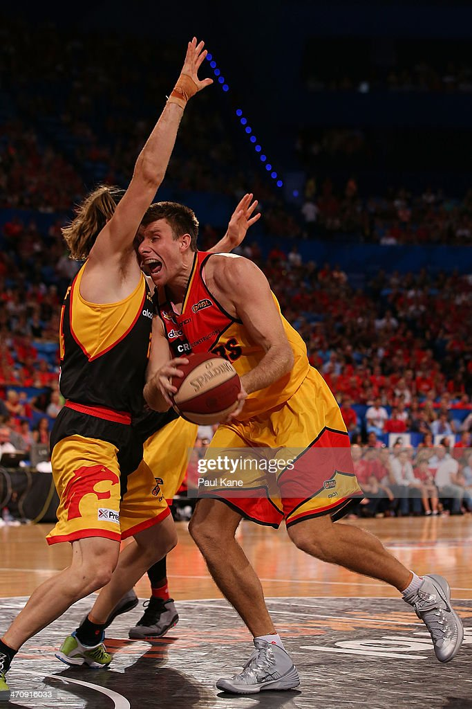 Jesse Wagstaff of the Wildcats fouls Scott Morrison of the Tigers during the round 19 NBL match between the Perth Wildcats and the Melbourne Tigers at Perth Arena on February 21, 2014 in Perth, Australia.