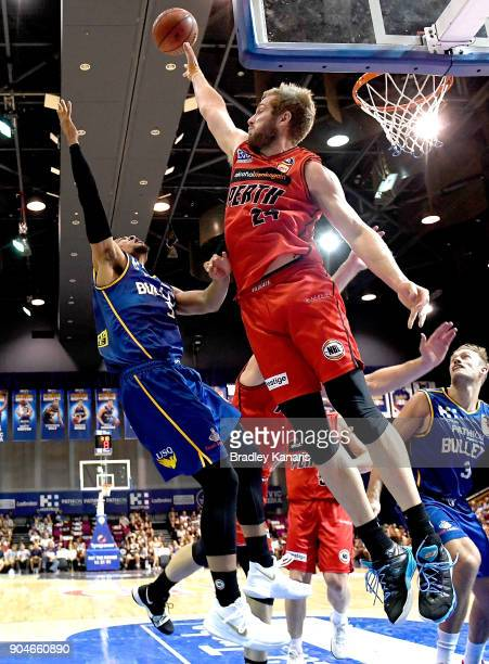Jesse Wagstaff of the Wildcats fouls Stephen Holt of the Bullets during the round 14 NBL match between the Brisbane Bullets and the Perth Glory at...